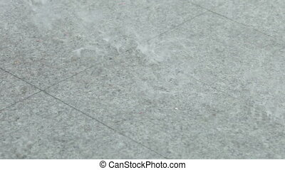 Rain on granite - On granite tiles dripping heavy rain