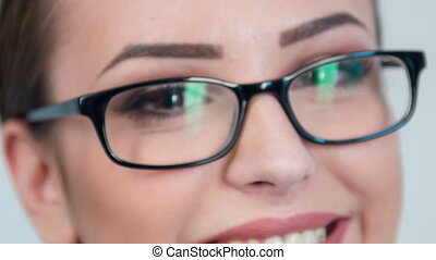 Close-up of lady in glasses.