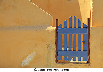 Blue gate in Greece - Image of a blue gate by an orange...