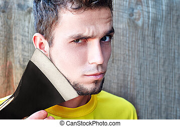 man shaves with an axe - Shaving with axe. Confident young...