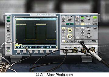 Compact industrial oscilloscope on desk closeup photo