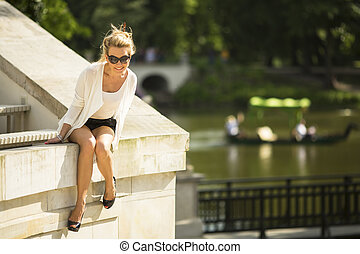woman sitting in the Park - Beautiful young woman sitting in...