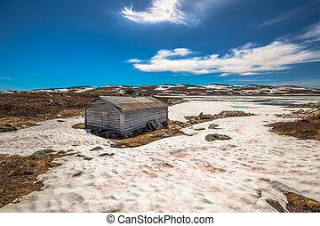 Mountain cabin in winter. Geilo in Hardangervidda Plateau....