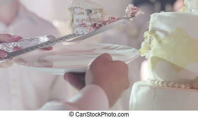 Cuting beautiful cake - Wedding cake with delicate hearts