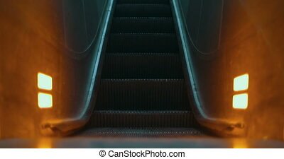 Illuminated escalator moving up - Illuminated empty...