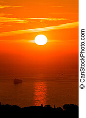 Sunrise on the sea with cargo stranded in the Bay of Algiers