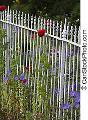 White fence with flowers