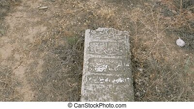 Old muslim cemetery tombstones on ground