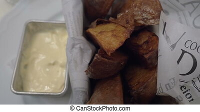 Eating baked potatoes with cream sauce - Close-up shot of...