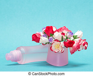 Floral perfume. Close-up of perfume bottle lying near...