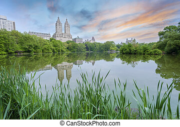 Central Park Sunset in New York City - The Lake In Central...
