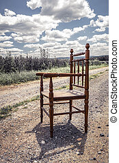 Chair on a dirt road