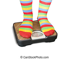 Feet on bathroom scale - Woman weighing herself on a...