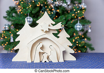 Blank wooden christmas crib with christmas tree as...