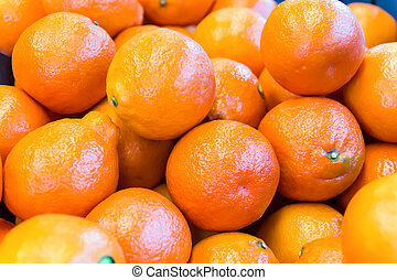 Fruit stack of many tangerines