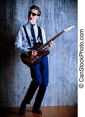 rock-n-roll - Expressive young man playing rock-