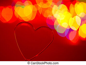 Valentine background - Red transparent plastic heart with...