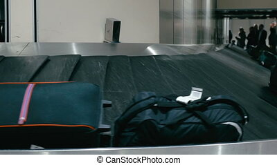 Travel bags on the conveyor belt at airport - Suitcases on...