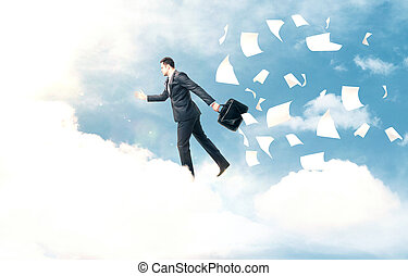 businessman jumping from cloud to another cloud