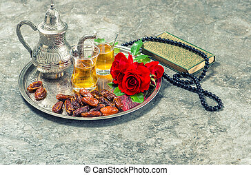 Tea, red rose flower, dates, holy book quran and rosary....