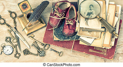 Antique books and photos, keys, baby shoes and writing...