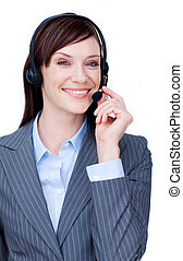 Positive customer service agent using headset against a...