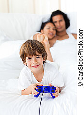 Liitle boy playing video games