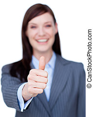 Portrait of an attractive businesswoman with thumb up...