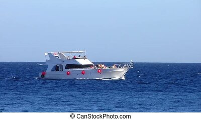 Motor boat  is moving along the shore of the Red Sea