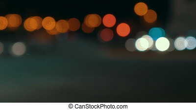 Timelapse of defocused night city traffic - Timelapse of...