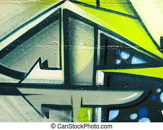 Bright graffiti painted on brick wall