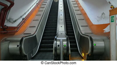 Empty underground escalator moving up - Empty escalator in...