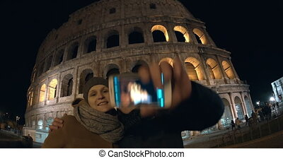 Couple making selfie in Rome at night - Wide angle shot of...