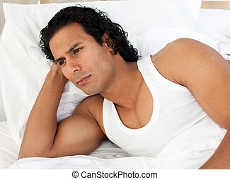 Angry man lying in the bed