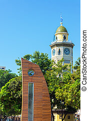 Sculpture and Moorish Clock Tower - Sculpture in front of...