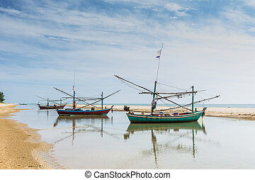 Fishing boats and coastal beaches in the south of Thailand