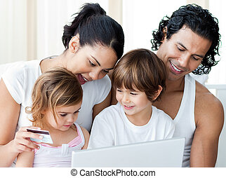 Close-up of a family shopping online at home