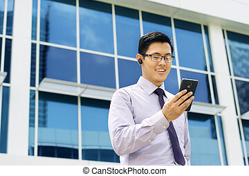 Businessman Talking Video Call On Mobile With Bluetooth...