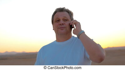 Man on vacation having a phone talk - Mature man on...