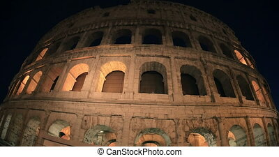 Sightseeing of Rome, Coliseum at night - Dolly and wide...