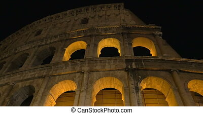 Night view of Roman Colosseum - Dolly and low angle shot of...
