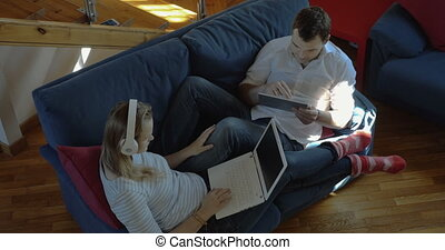 Teamwork at home with tablet PC and laptop - High angle shot...