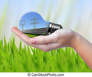 Hand holding eco light bulb Green energy concept