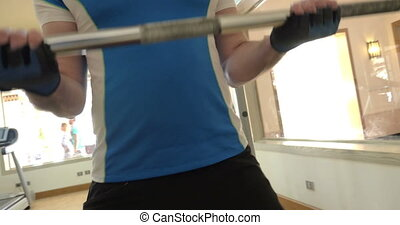 Man making efforts in exercise with crossbar
