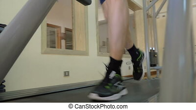 Working out with cardio machine - Steadicam low angle shot...