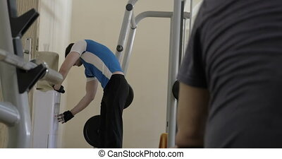 Man drinking water during break in the gym - Young man in...