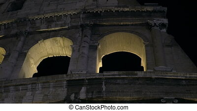 Night Coliseum. Ancient Roman landmark - Dolly, close-up and...