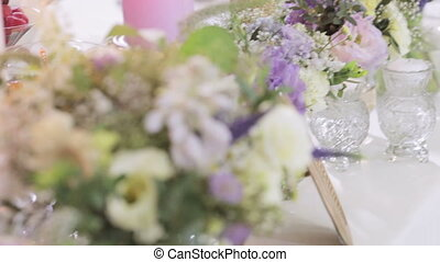Decorative bouquet to served table - On festive table is...