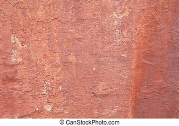 ocher wall - Background of a ocher natural stone wall