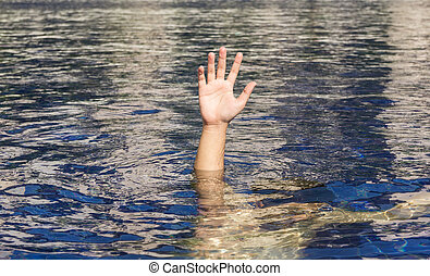 Hand of drowning man in a swimming pool